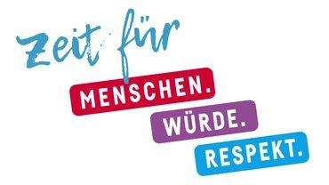 """Schriftzug """"Zeit für Menschen, Würde, Respekt"""""""